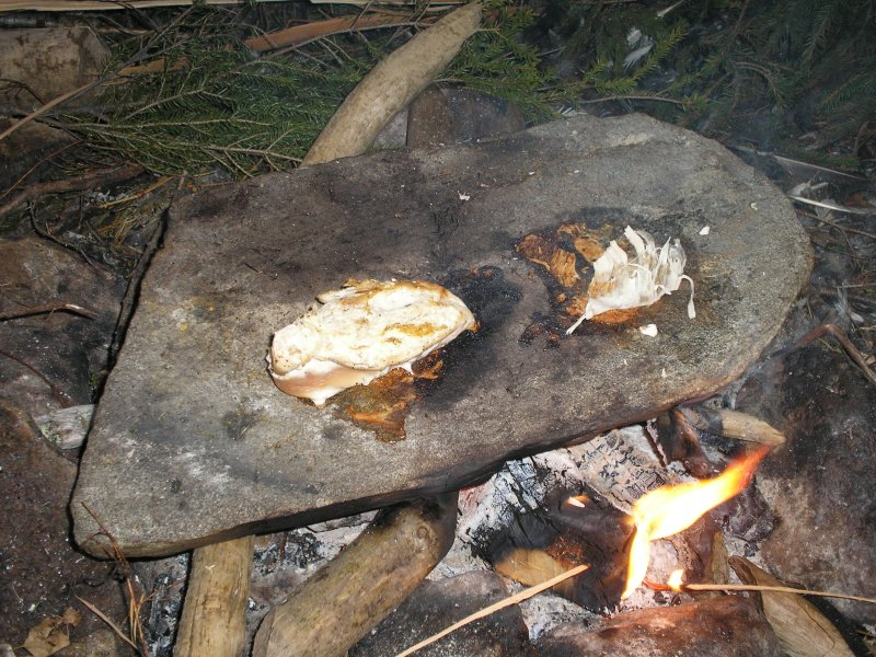 Living Primitively Cooking Directly On Fire